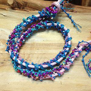 1 Meter Perlenfaden mit Rocaillesperlen lila violett 2 mm