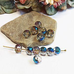 4 Facettierte und geschliffene Glasperlen blau irisierend 12 x 10 mm